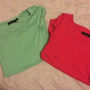Two XS short sleeved shirts.